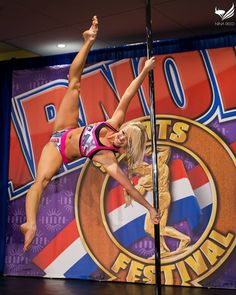 That toe point is EVERYTHING! How amazing does Tara Meyer look in the Pole Championship Series/ Arnold Sports Festival PoleFit® Exclusives! #BadKittyPride Photo by Nina Reed Photography