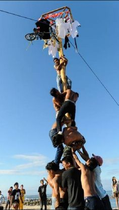 Climb the pole: Men are working together to climb a betel pole in a Independence Day celebration in Nusa Dua, Bali