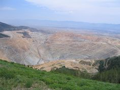KENNECOTT COPPER MINE is 3/4 of a mile deep and 2-3/4 of a mile wide at the top.  You could stack two Sears Towers on top of each other and still not reach the top of the mine.