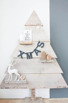 Louise de MirandaSave to IdeabookEmail Photo Van Soeren's father made a scrap-wood tree with small shelves to hold holiday accessories. Woo...