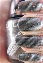 Buzzy as. Just discovered this nail polish that has magnetic fragments in it. When you put it on you use a magnet to separate the colours into this galaxy effect. WANT. NZ$23.90 not bad.