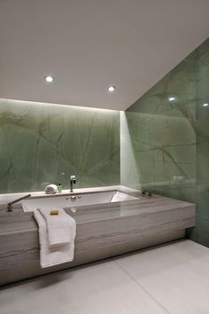 David Howell Design, oversized bathtub with indirect lighting and subtle color scheme #bathrooms