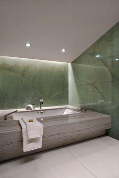 David Howell Design, oversized bathtub with indirect lighting and subtle color scheme #bathrooms