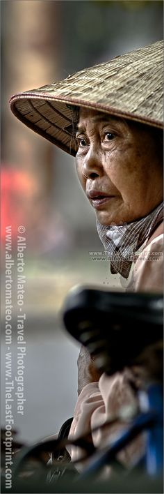 Portrait of woman, street seller in Hanoi old quarters, Vietnam. Photograph byAlberto Mateo, Travel Photographer.