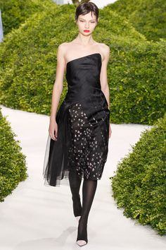 Christian Dior Spring 2013 Couture - Style.com    I like how the bold print peeps through the opaque and sheer black stripes. The angled neckline gives a modern touch to cute and playful dress.