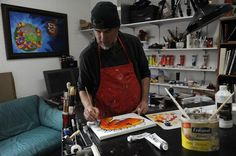 Daniel Sorensen works in his studio at the Aurora Cultural Art District Studios & Galleries on Dec. 26. ACAD is working on filling all of the space at