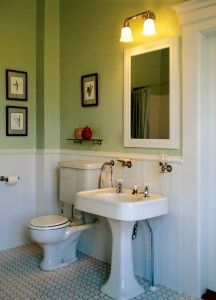 The pedestal sink and toilet are original to the bath in this 1872 Italianate; Patrick and Joyce added new period-style flooring, lighting, and accessories.