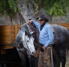 Handsome cowboy and a beautiful horse - photo by Bev Pettit