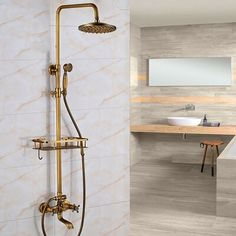 Cordoba Antique Brass Wall Mount Shower Set is the perfect choice for a bathroom that takes a contemporary yet minimalist approach to design. It has a streamlined look and appeal, and the wonderful and sleek polished brass finish sure adds a modern twist to the shower set. Aside from that, the shower mixer features laser printed dials which do not wear out easily and incorporates the latest ceramic disc technology for optimal performance. The handheld shower is just as great, with solid water pr Brass Shower Head, Gold Shower, Shower Set, Rain Shower, Shower Heads, Attic Shower, Bathroom Shower Faucets, Shower Fixtures, Brass Bathroom