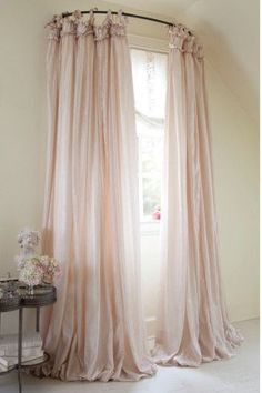 want for the bed room! use a curved shower rod for window treatment. LOVE this idea!