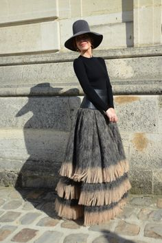 Our 25 Favorite Street Style Snaps from Paris Fashion Week: We want to curl up in designer and photographer Ulyana Sergeenko's skirt and hibernate in style all winter long.