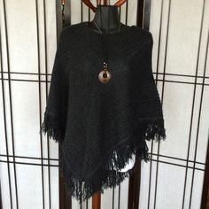 C Banks black knitted poncho Warm, cuddly poncho. In great condition. Washed and worn a couple times, but no snags or holes. Not itchy. Christopher & Banks Sweaters Shrugs & Ponchos