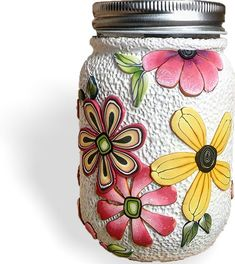 Florida's Pamela Carman makes a mean Mason jar. This big floral one has actually been upcycled with one of those fancy liquid soap pumps. The background for her flowers is textured white clay. Pamela's big blooms allow her to create a quick com [...]