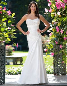 Sincerity wedding dress style 3918 A uniquely beaded stretch satin and Venice lace strapless gown with an asymmetrical waistline, illusion back, pearl buttons, and chapel length train.
