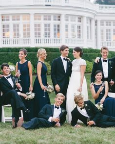 The groom, in Brooks Brothers, and the bride, in Jenny Packham, posed with their bridal party in front of her family's home.