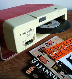 "1975, the ""Mady 2"" portable record player was made by Italian company Lesa; it was battery powered and played 45s, which loaded through the slot in the front. Although not stereo it was innovative."
