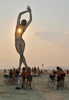 "Go to the Burning Man festival (""Truth is Beauty"" by Marco Cochrane at Burning Man 2013)"