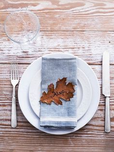 Fall foliage makes for simple place cards. / 30 Cute And Clever Ways To Decorate For Thanksgiving