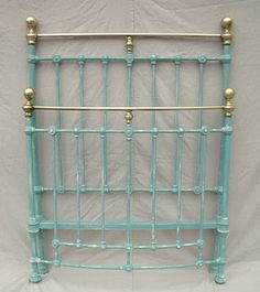 Stunning twin iron and brass bed painted in chalk paint, distressed just right!