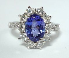 Tiffany & Co. Tanzanite Diamond Platinum Engagement Ring | From a unique collection of vintage engagement rings at http://www.1stdibs.com/jewelry/rings/engagement-rings/