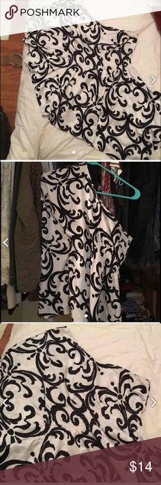 Black and white one shoulder blouse Flowy and silly material. Purchased on Posh, but haven't worn it. Tag says it's a small, but can fit a size Small. Tops Blouses