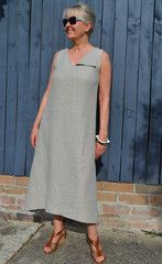 SophieDress –this flared dress features a one lapel v-neckline, drop waistline and ce...