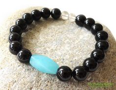 This gorgeous Blue Amazonite and Black Onyx has healing properties to protect against negative energies.  Each bracelet has been infused with healing Reiki and Kuanyin energies and smudged before shipping.