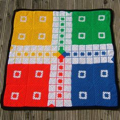 In UK we call this game Ludo. It has alternative names in other countries. As you might guess Granny's Ludo is basically made of crochet granny Crochet Game, C2c Crochet, Crochet Squares, Crochet Blanket Patterns, Crochet Gifts, Crochet For Kids, Crochet Toys, Granny Squares, Yarn Crafts For Kids