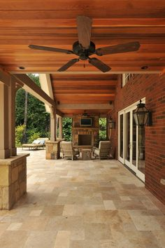 The outdoor space on this covered porch has year-round appeal; when it's too chilly for a dip, the family can gather by the outdoor fireplace and watch postseason football games.
