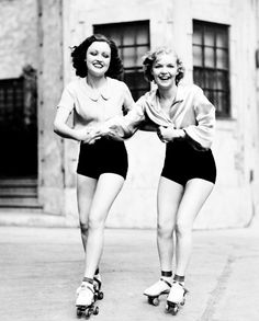 #1930sfashion Two dames roller skating. >