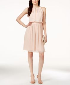This draped, key-hole bridesmaid dress dials up the romance with tons of wear-it-again appeal.