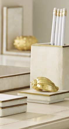Exquisitely crafted with white crystallized stone or green penshell, inlaid by hand, our Crystal Desk Accessories are adorned with gold electroplated sea life.