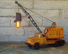 This very cool 1960 Tonka Dragline Truck was the perfect start to a unique one of a kind lamp. It has an amazing color that only time could