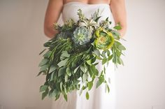 A bouquet of succulents, air plants, kale, and other greenery | Photo by Bit of Ivory | Floral design by Roost