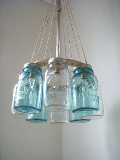 Western Wear Wagon Wheel - Clear and Ocean Blue Quart Sized Mason Jar Chandelier Light - Upcycled Lighting Fixture Lights Lake House. $200.00, via Etsy.