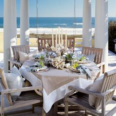 Outdoor beach dining. Love the tablecloth (and view, of course)