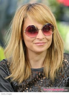 long bob with bangs.  Google Image Result for http://static.becomegorgeous.com/gallery/pictures/nicole-richie-long-bob-with-bangs-becomeogorgeous.jpg