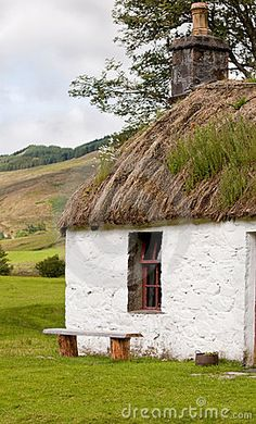 Grass roof...Close up detail of an old crofters cottage in the Scottish Highlands