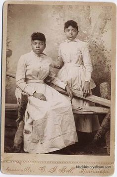 Full length double portrait, two young African American women in identical dresses. ca. 1875. Randolph L. Simpson African-American collectio...