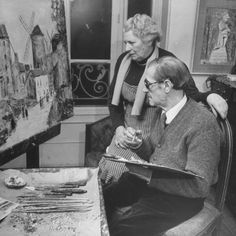 Maurice Utrillo Painting an Old Scene, While Discussing it with Artist Wife, Lucie Valore    by Dmitri Kesse