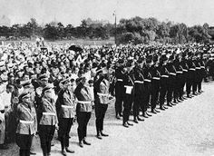 Hitler Youth members hold a symbolic greeting ceremony for Emperor Hirohito on Nijubashi Bridge at the entrance to the Imperial Palace, Tokyo, during a hitler-jugend group visit to Japan in September and October, 1938.