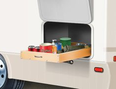 Here is a tip for combating compartment storage problems. Using garage-door tracks and hardware, you can make a guide and use rollers attached to the sides of the compartment. The drawer sli… Trailer Life Magazine, Garage Door Track, Exterior Grade Plywood, Lite Travel Trailers, New Home Construction, Building A New Home, Wall Outlets, Build Your Dream Home, Exterior Doors