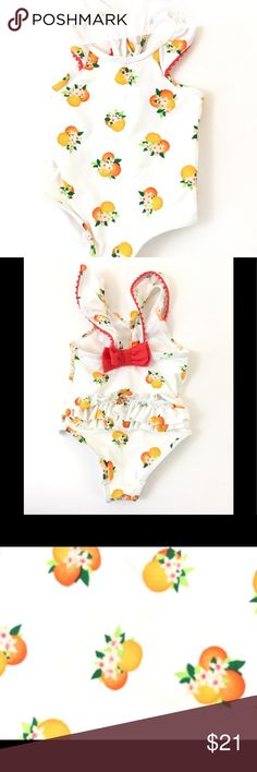 Kate Spade Baby Orangie swimsuit 12 M 🍊🍊 • Kate Spade baby swim suit • Never worn in water • Gentle use  • Bottom area has a slight texture surface snag from sitting on concrete near pool- see pictures to reference • Size 12 M • NOTE: color may vary due to camera flash, lighting and monitor screen kate spade Swim One Piece