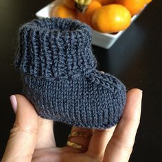 Stay-on baby booties knit up quickly in one piece finished with a single seam. // Stay-On Baby Booties by Churchmouse Yarns & Teas // Marion Foale 3-ply