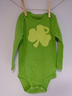 Lucky in Love Onesie (tutorial), St. Patrick's Day Crafts @Heather Ferguson and @Lena Brown... want to get together and make onesies for our little some time?  This one looks super easy... you use green dye to dye the whole thing, so if we did it together, we wouldn't ahve to waste any dye!