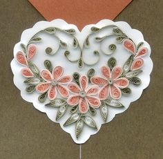Quilling hearts from paper flowers...tutorial for making quilled flowers and examples of heart quilled designs...very pretty!!