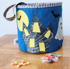 A dress up your pop up kit. Make a cute Halloween candy bin that collapses for easy storage. Kit includes one medium spring, elastic and a label. A haunted house with ghost and spider with black cauldron will complete any Hallows Eve decor.