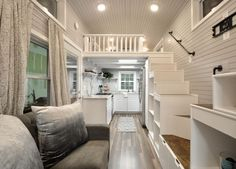 This is the gorgeous Kate by Tiny House Building Companythat's for sale! The inside of this tiny house on wheels is absolutely stunning. The home features two queen-sized lofts accessible by…
