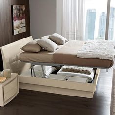 small bedroom with storage under mattress