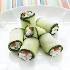 """This kid-friendly """"sushi"""" is actually cucumber strips stuffed with goat cheese and bell pepper."""